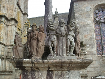churchyard: stone sculptures at a historic church with parish close in Saint-Thegonnec in Brittany, France Editorial