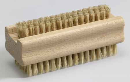 wooden nail brush in light grey back Stock Photo