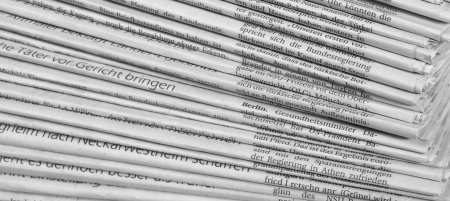 writing western: full frame background with lots of stacked newspapers