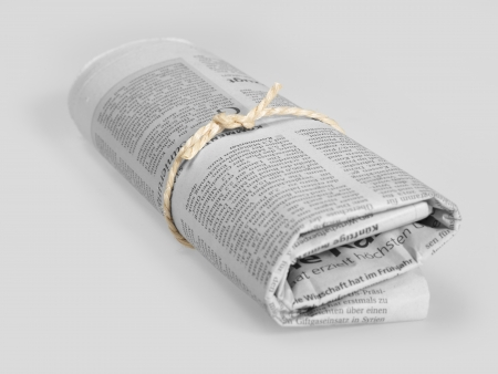 rolled german newspaper in grey back