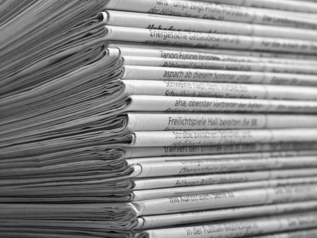 gazette: full frame background with lots of stacked newspapers