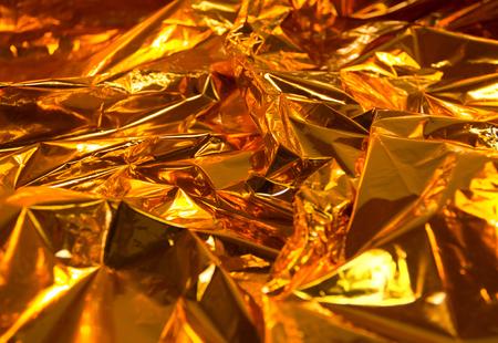 full frame creased gold foil background photo