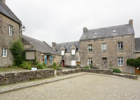 tourist feature: street view of Locronan, a idyllic medieval village in Brittany, France