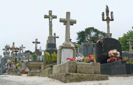 commune: churchyard at Locronan, a idyllic medieval village in Brittany, France