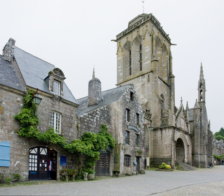 commune: street view of Locronan, a idyllic medieval village in Brittany, France