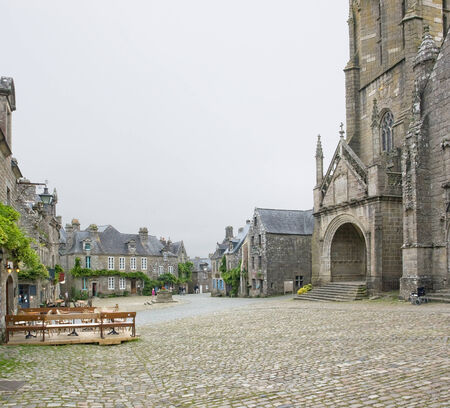 commune: street view of Locronan, an idyllic medieval village in Brittany, France