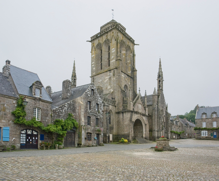 clouded: street view of Locronan, a idyllic medieval village in Brittany, France