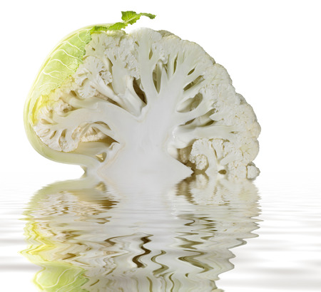 a halved cauliflower and reflective water surface