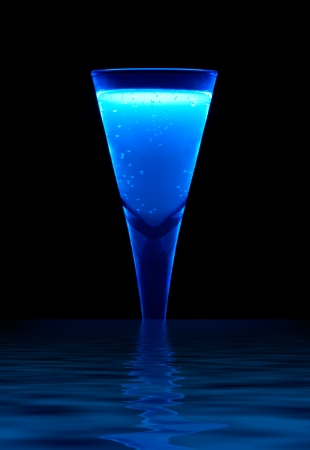 a fluorescent illuminated drink on reflective water surface in dark back