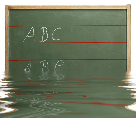 home schooling: sinking red lined old blackboard with written ABC on it on reflective water surface in white back Stock Photo