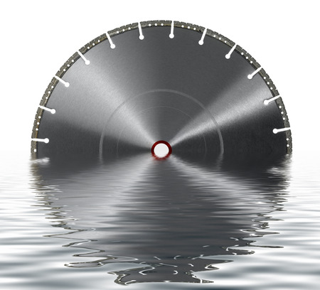 diamond studded cutting wheel on reflective water surface in white back Stock Photo