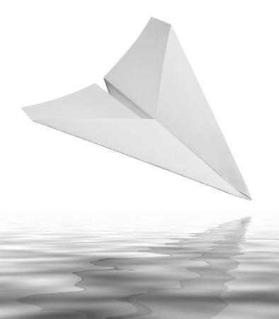 wavily: falling white paper plane on reflective water surface in white back Stock Photo