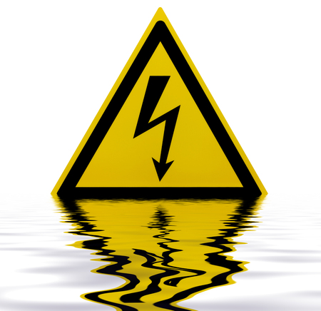 sunken High Voltage Sign on reflective water surface in white back Stock Photo