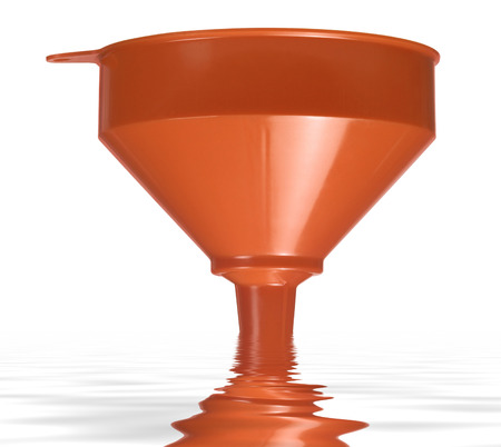 orange funnel dipped on reflective water surface in white back