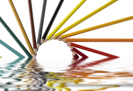 sunken pencil arrangement on reflective water surface in white back