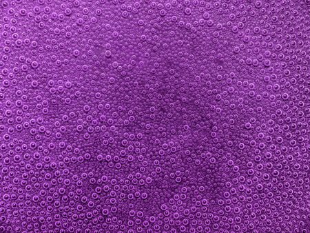 air bladder: full frame abstract underwater background with lots of small air bubbles in violet ambiance Stock Photo
