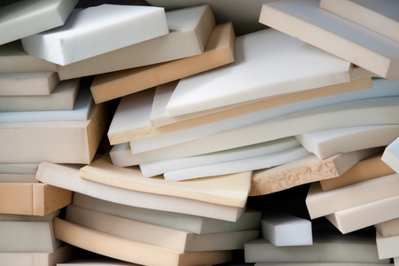 insulate: lots of various stacked foam mats Stock Photo