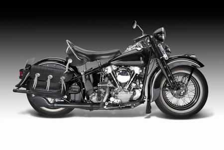 sideways shot of a vintage motorbike in gradient back 스톡 콘텐츠