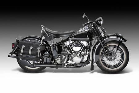 sideways shot of a vintage motorbike in gradient back Standard-Bild