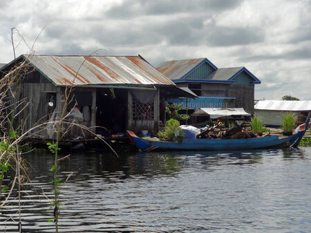 pile dwelling: waterside scenery with rural houses at the Tonle Sap, a river in Cambodia