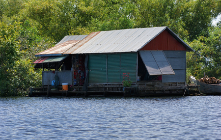 stilt house: waterside scenery with rural house at the Tonle Sap, a river in Cambodia