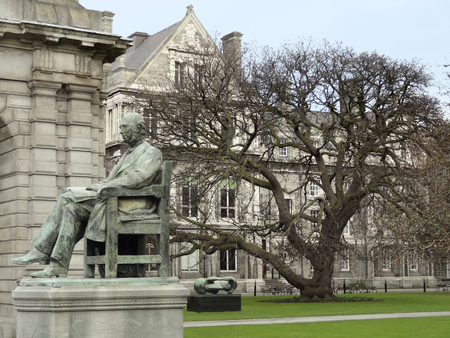 urbanized: the Trinity College with statue of George Salmon in Dublin, Ireland