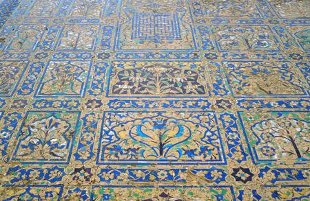 ka: historic colorful inlay work at a building named Chini Ka Rauza in Agra, India