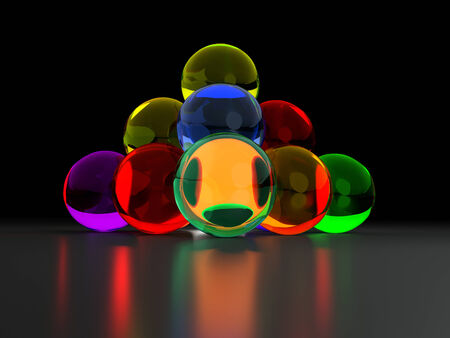 reflectance: rendering of a small pyramid made of transparent colored glass balls in dark reflective back Stock Photo