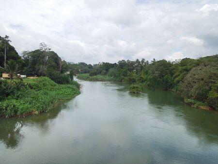 ambiance: waterside scenery in Sri Lanka in cloudy ambiance