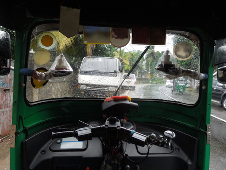 auto rickshaw: scenery inside of a exotic small auto rickshaw taxi in Sri Lanka Stock Photo