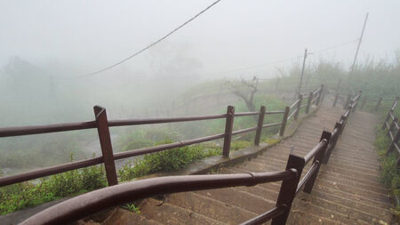 moistness: foggy scenery including a stairway to a mountain in Sri Lanka named Adam´s Peak Stock Photo