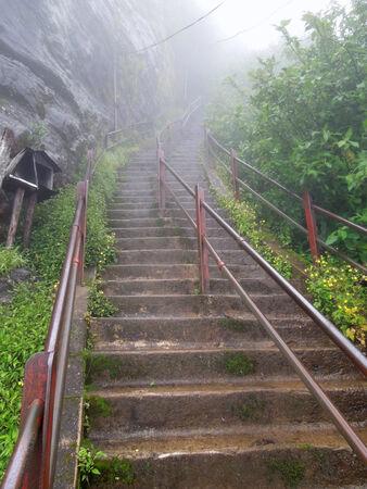 adams: foggy scenery Including a stairway to a mountain in Sri Lanka named Adams Peak Stock Photo