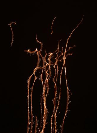 detonation: sparkling fireworks display in dark back Stock Photo