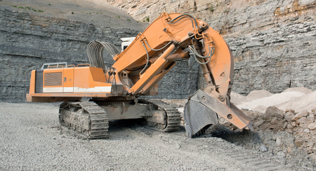 tracked: tracked excavator in a quarry Stock Photo