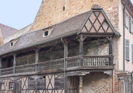 roofed house: historic wooden balcony at a old building in Colmar, Alsace, France