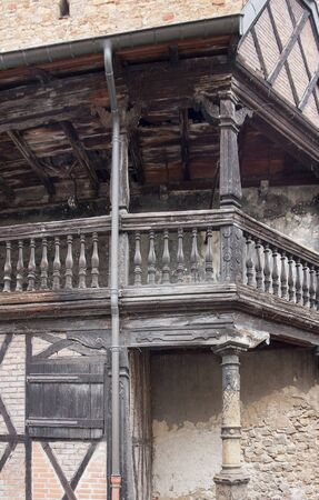 bannister: detail of a historic wooden balcony at a old building in Colmar, Alsace, France