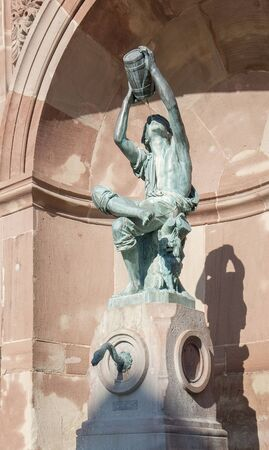 waterspout: drinking figure on a waterspout fountain in Colmar, a city in Alsace, France