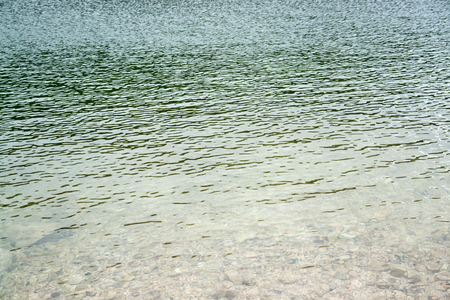 shallow water: littoral detail with stones and shallow water Stock Photo