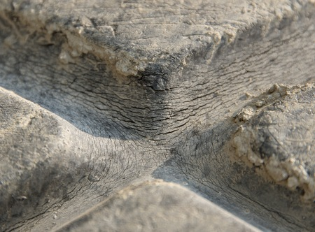 tyre tread: full frame detail of a fissured rubber tire Stock Photo