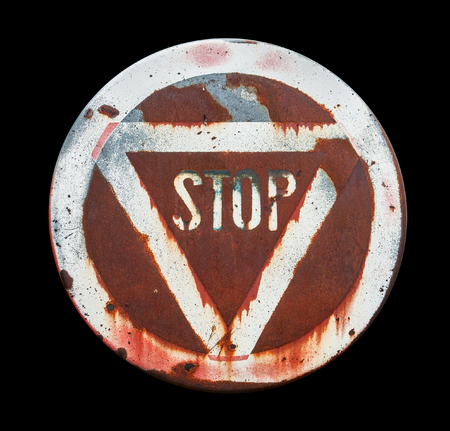 flawed: a old weathered stop sign in black back