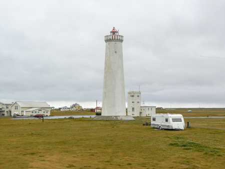 clouded: clouded scenery inluding a white lighthouse seen in Iceland