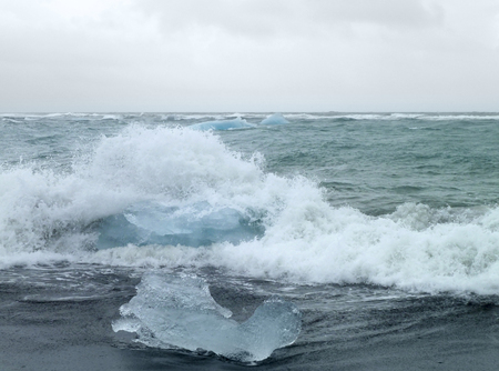 wavily: coastal scenery with iceberg seen in Iceland Stock Photo