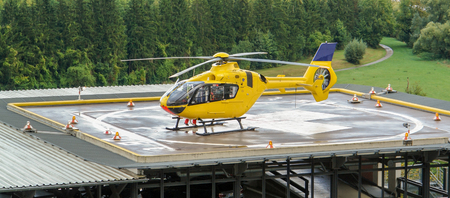 helideck: a yellow helicopter on helideck Stock Photo