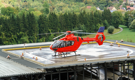 helideck: a red helicopter on helideck Stock Photo