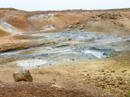 basin mountain: rocky scenery including a hot spring seen in Iceland Stock Photo