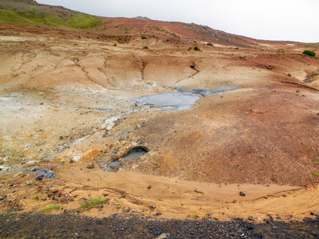 volcanism: rocky scenery including a hot spring seen in Iceland Stock Photo