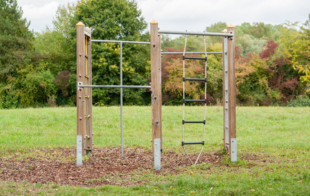 climbing frame: outdoor playground scenery with climbing frame, lawn and trees