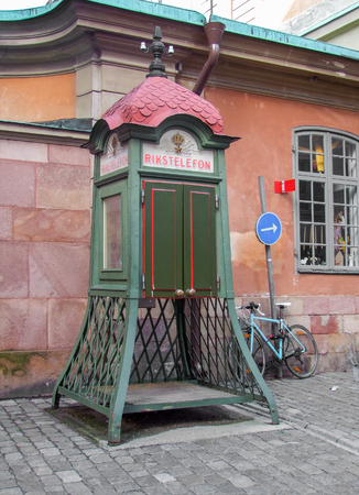 urbanized: historic phone box seen in Stockholm, the capital of Sweden