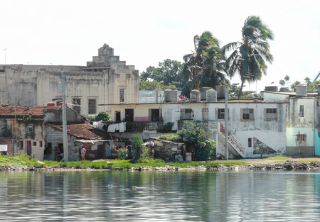 rundown: waterside scenery including rundown houses in Cuba, a island in the Caribbean sea Stock Photo