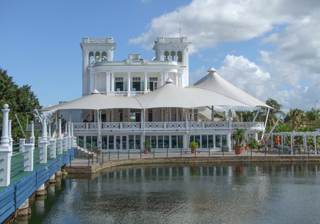 house coats: waterside feudal building in Cuba, a island in the Caribbean Sea Stock Photo